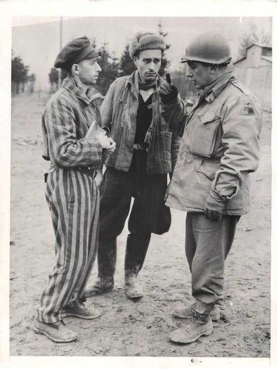Major John R. Scotti talking to survivors Ohrdruf